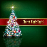 Greeting with Christmas tree on green grunge background Stock Photos