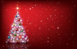 Greeting with Christmas tree on red background. Abstract red background with Christmas tree and decorations Stock Photo