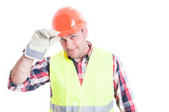 Greeting concept with handsome builder showing respect. Isolated on white background Royalty Free Stock Image