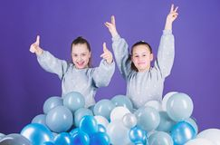 Greeting concept. Having fun concept. Balloon theme party. Girls friends near air balloons. Start party. Birthday party. International childrens day. Carefree royalty free stock photography