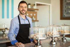 Greeting customers into his bakery Royalty Free Stock Photos