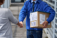 Greeting delivery man Royalty Free Stock Photography