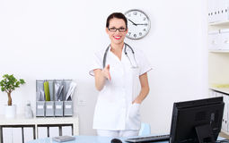 Greeting female doctor Royalty Free Stock Photography