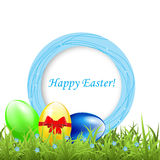 Greeting frame with easter eggs on grass Royalty Free Stock Photography