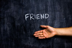 Greeting a friend. Drawing and hand by blackboard Stock Photos