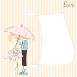 Girl kiss boy under umbrella Royalty Free Stock Photography