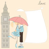 Girl kiss boy under umbrella in London Royalty Free Stock Photos