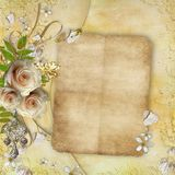 Greeting golden card with beautiful flowers. Greeting golden card with beautiful  roses, paper hearts, ribbon, leaves Royalty Free Stock Photography