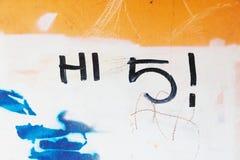 Graffiti tag hi 5 written on grungy wall. Greeting graffiti tag reading hi 5 on grungy wall royalty free stock photos