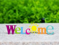 Greeting. Welcome sign sign three-dimensional shape single word hello text Stock Photos