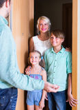 Greeting guests at the door Royalty Free Stock Images