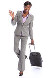 Greeting from happy black woman on business travel Royalty Free Stock Images