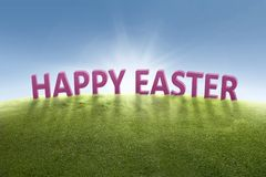 Greeting of Happy Easter on the green grass Royalty Free Stock Photography