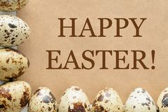 Greeting Happy Easter and quail eggs royalty free stock images