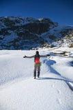 Greeting hiking woman on snow Royalty Free Stock Photos