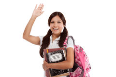 Greeting Hispanic College student. Education series - Friendly ethnic Latina female high school student with backpack and composition book, gesturing and Stock Photo