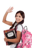 Greeting Hispanic College student. Education series - Friendly ethnic Latina female high school student with backpack and composition book, gesturing and Royalty Free Stock Photo