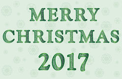 Greeting with Merry Christmas in shades of green Stock Images