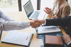 Greeting new colleagues, Handshake while job interviewing, male candidate shaking hands with Interviewer or employer after a job stock photography