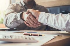 Greeting new colleagues team, business people shaking hands duri Royalty Free Stock Image