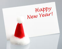 Greeting New Year card and Santas hat Royalty Free Stock Photo