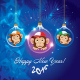 Greeting the New Year of the Monkey. Christmas greeting card with a Christmas tree balls with painted monkeys Stock Photography