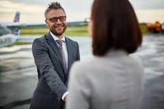 Greeting newly arrived colleague Stock Image