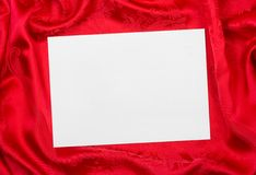 Greeting paper card on red cloth Stock Photo