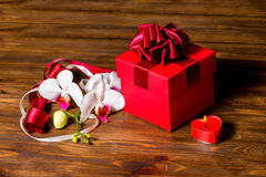 Greeting red box with bow, candle heart and orchid flower, phala Royalty Free Stock Photography