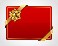 Greeting red card with gold bow Royalty Free Stock Photography