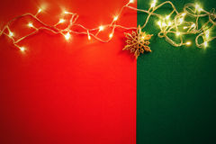 Greeting Season concept.Christmas light and pine star on red and Royalty Free Stock Image