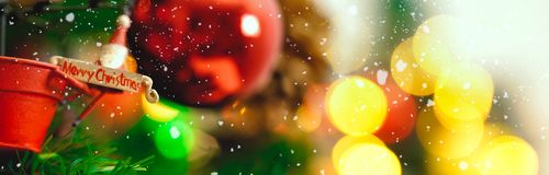Greeting Season concept.wide shot of ornaments on a Christmas tr Royalty Free Stock Photography