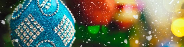 Greeting Season concept.wide shot of ornaments on a Christmas tr Stock Photo