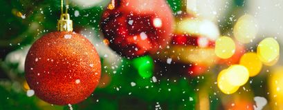 Greeting Season concept.wide shot of ornaments on a Christmas tr Royalty Free Stock Images