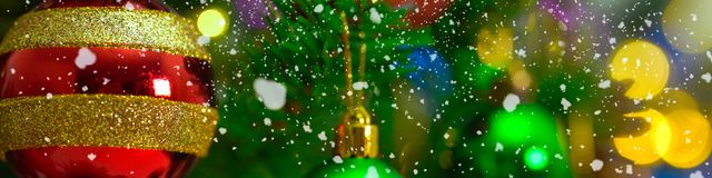 Greeting Season concept.wide shot of ornaments on a Christmas tr. Ee with decorative light Stock Images