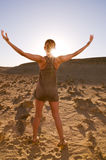 Greeting the sun in desert Stock Photography