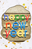 Greeting text Happy New Year on woods in a snowy frame. Greeting text Happy New Year on wooden background in a snowy frame stock image