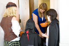 Greeting the Trick or Treaters stock photos