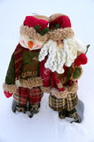 After greeting. Two Christmas toys on a snow background Royalty Free Stock Photography