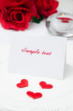 Greeting Valentine's Day card on a plate, roses and candle, sele Royalty Free Stock Photo
