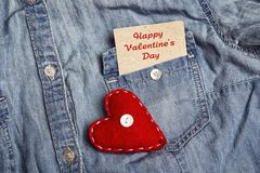 Greeting Valentines Day card in pocket of denim shirt and red he. Art. Happy Valentine`s Day Royalty Free Stock Photos