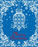 Greeting vintage blue Christmas card with floral paper cut out hanging whit bell, snowflakes and floral decorative border Stock Photo