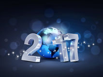 2017 Greeting world symbol. 2017 New Year type composed with a blue planet earth, on a sparkling black background - 3D illustration Royalty Free Stock Images