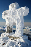 Greetings. A snow covered Inuksuk, traditional native design and official symbol of the 2010 winter olympics, welcomes visitors to Whistler, BC Stock Photography
