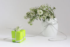 Greetings. Card with white flowers and gift Royalty Free Stock Photos