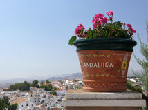 Greetings Andalusia.  flowers, old town & summer. Postcard from Andalusia. Panorama of the small town Colmenar about 50 km north of Malaga Stock Photos