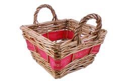 Greetings basket. Basket with red greetings ribbon Royalty Free Stock Photos