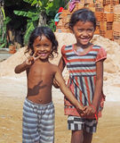 Greetings from Cambodian Children. Warm and friendly Cambodian children chant hello to visiting tourists Stock Images