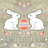 Greetings card with easter eggs and two rabbits Royalty Free Stock Photography