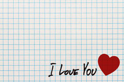 Greetings card to St.Valentines Day with red heart symbol and text I love You on page of students notebook Stock Photos